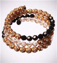 Jewellery. Black and Gold Bracelet. This bracelet is designed on a spring wire that wraps around the
