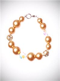 Jewellery. Gold Pearl Bracelet. A mix of gold pearls in 6 and 8mm pearls are offset with irridesent