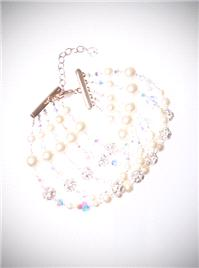 Jewellery. Wide Jewelled Bracelet. A statement bracelet, this piece is designed using white pearls,