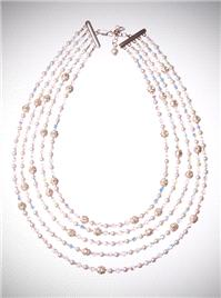 Jewellery. Collar Necklace. This statement neck piece has five strands made using Swarovski crystals