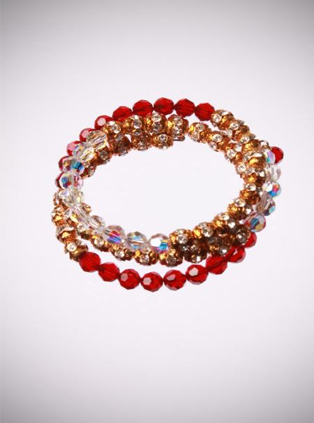 Jewellery, Red and Gold Bracelet. This bracelet is designed on a spring wire that wraps around the w