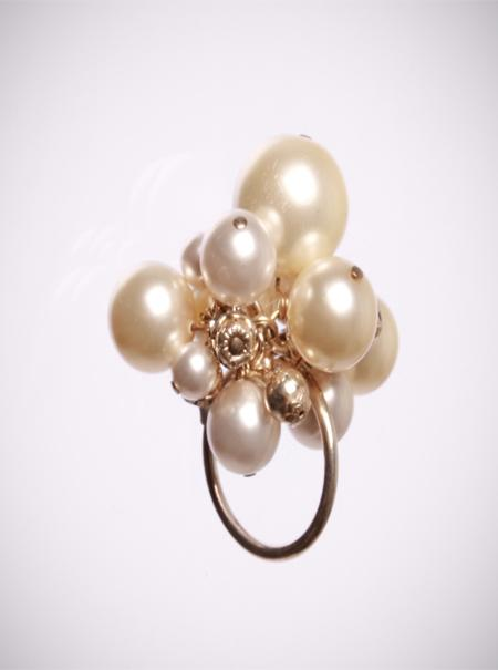 Jewellery, Cream Cocktail Ring. A statement ring on a sterling silver shank, it is embellished with