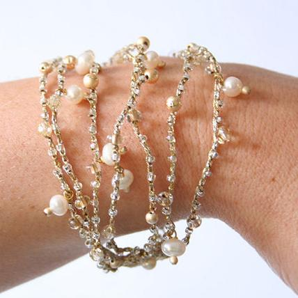 Jewellery, Crochet Strand Bracelet. This delicate bracelet is made from pale gold crochet and is emb