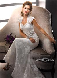 Bridal Dresses. Lady Lara wedding dress. Sweetheart neckline, delicate sleeves and covered buttons a