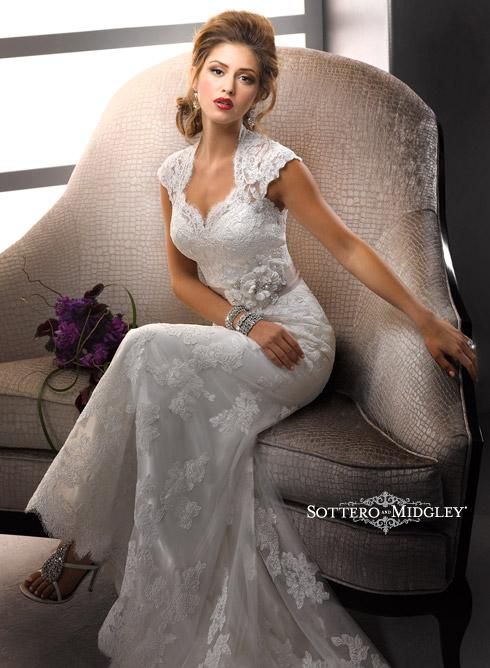 Bridal Dresses, Lady Lara wedding dress. Sweetheart neckline, delicate sleeves and covered buttons a