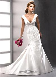 Bridal Dresses. Lady Guinevere wedding dress. Chic and alluring, the slenderizing drape of this glor