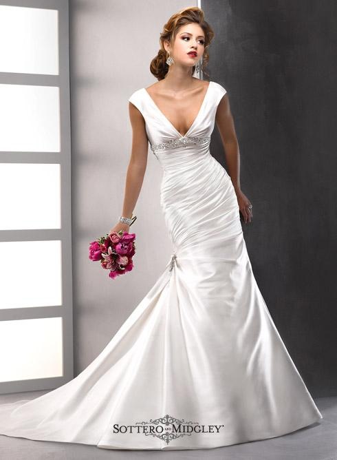 Bridal Dresses, Lady Guinevere wedding dress. Chic and alluring, the slenderizing drape of this glor