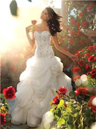 Bridal Dresses. Belle wedding dress. Elaborate draping, folding and pleating make up this ball gown