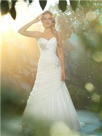 Bridal Dresses. Rapunzel wedding dress. Confident and sophisticated, this fitted gown of draped, sof