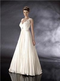 Bridal Dresses. Alexandria wedding dress. The neck line is sweet heart/v neck. It is heavily encrust