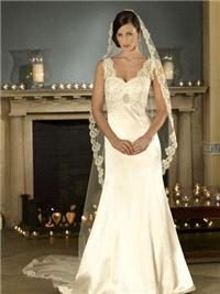 Bridal Dresses. Marie-Anna wedding dress. Soft sweet heart/v neck neckline, The lace  is encrusted w