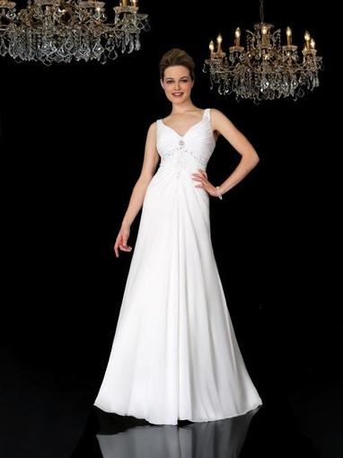 Bridal Dresses, Carolyn wedding dress. Slight sweet heart neck line with a soft A line skirt. It has
