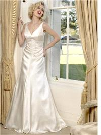 Bridal Dresses. Aibhe wedding dress. This dress is a soft V neck shape on top that follows into a so