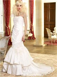 Bridal Dresses. Felice wedding dress. This dress has a one-shoulder organza  strap that leads into a