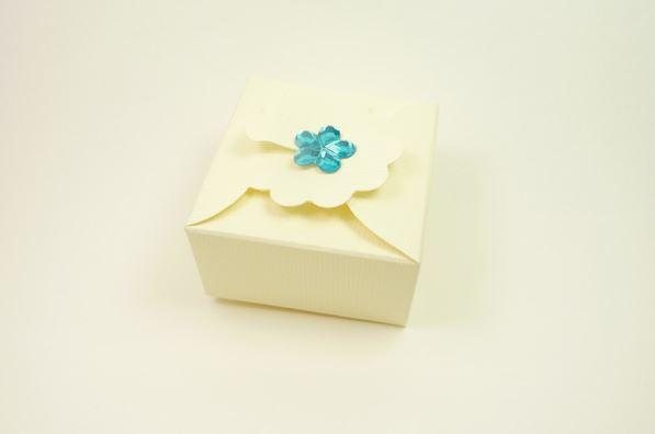 Accessories and Favours, Ivory Silk Margherita favour box (H:30mm, W:55mm, D:55mm) adorned with a pe