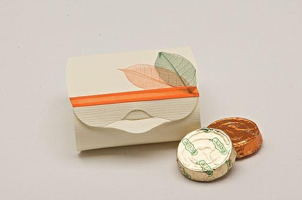 Accessories and Favours, Ivory Silk Couvette favour box (H:30mm, W:65mm, D:45mm) decorated with an o