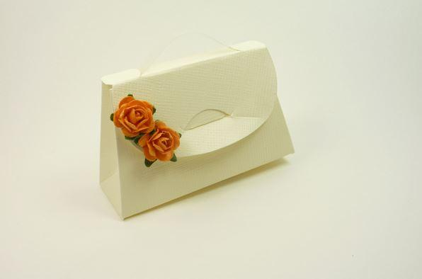 Accessories and Favours, Ivory Purse favour box (H:55mm, W:80mm, D:30mm). Decorated with a pair of o
